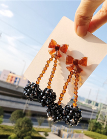 Fashion Black-brown Rice Beads Bow Earrings