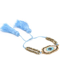 Blue + Gold Rice Bead Braided Eye Crystal Tassel Bracelet