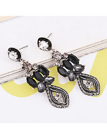 Fashion Antique Silver Oval Shape Diamond Decorated Eyes Shape Simple Earrings